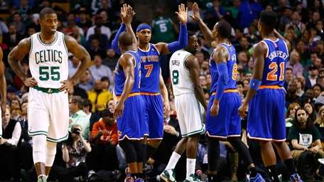 Carmelo Anthony of the Knicks is congratulated by