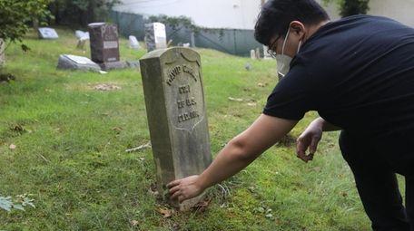 Stony Brook graduate Gary Ghayrat, visits the grave