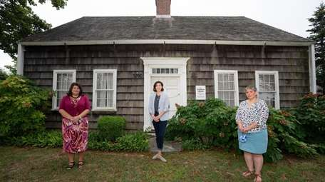 Amy Folk, far right, curated the Southold Historical