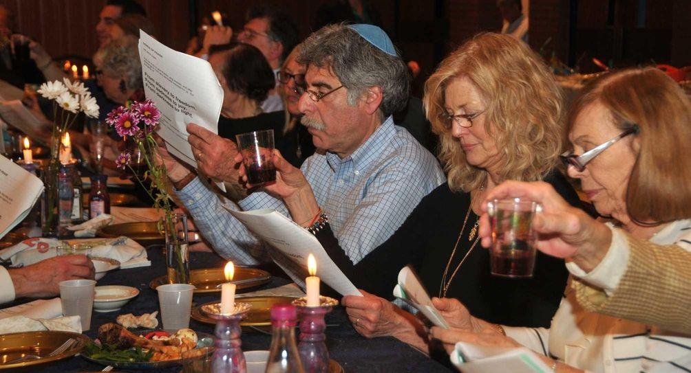Carol Feig, center, with husband Bill, left, celebrate