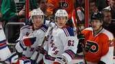 Derek Stepan, left, of the Rangers celebrates his