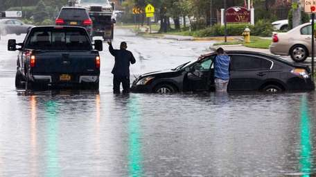 Flooding from heavy rainfall caused several cars to