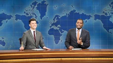 """Weekend Update"" anchors Colin Jost, left, and Michael"
