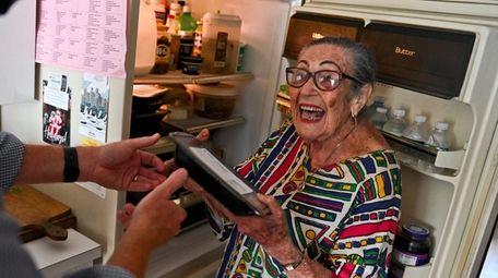 "Bernice ""Bunny"" Myones, of Seaford, receives a food"