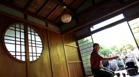 Guide Stephen Morrell demonstrates Japanese tea service at