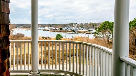 The three-bedroom, 2½-bath home has wraparound balconies on