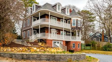 This three-story home with three bedrooms and 2½