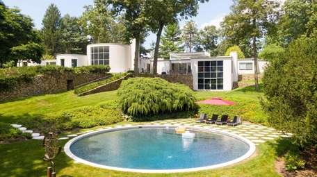 The rear grounds include a saltwater pool, tennis