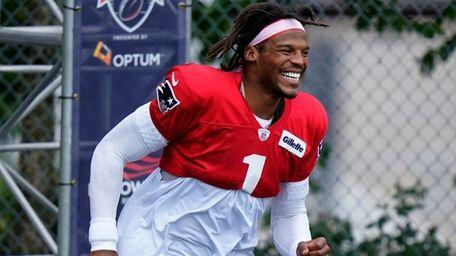 New England Patriots quarterback Cam Newton smiles as