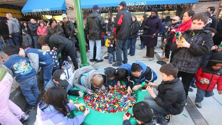Children play with Legos while waiting for the
