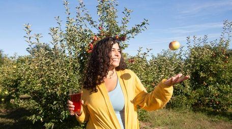 Brooke Roberts, of Centereach, enjoys a raspberry pint