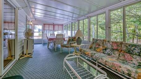 The mobile home comes with a sunroom.