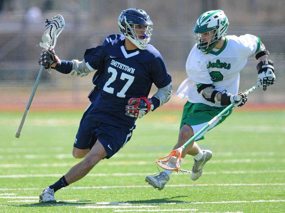 Smithtown West's Dylan Gruder, left, gets pressured by