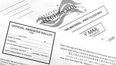 An absentee ballot sits on a table with