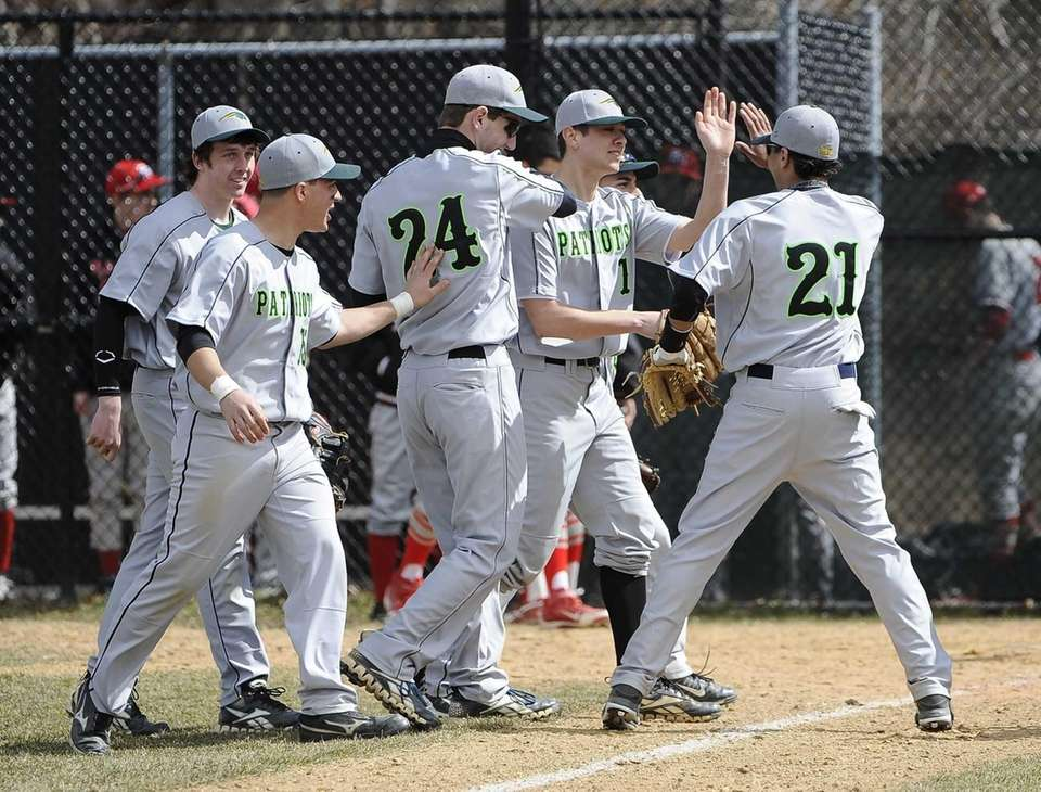 Ward Melville pitcher Anthony Kay and teammates celebrate