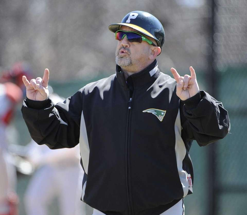 Ward Melville coach Lou Petrucci signals during the