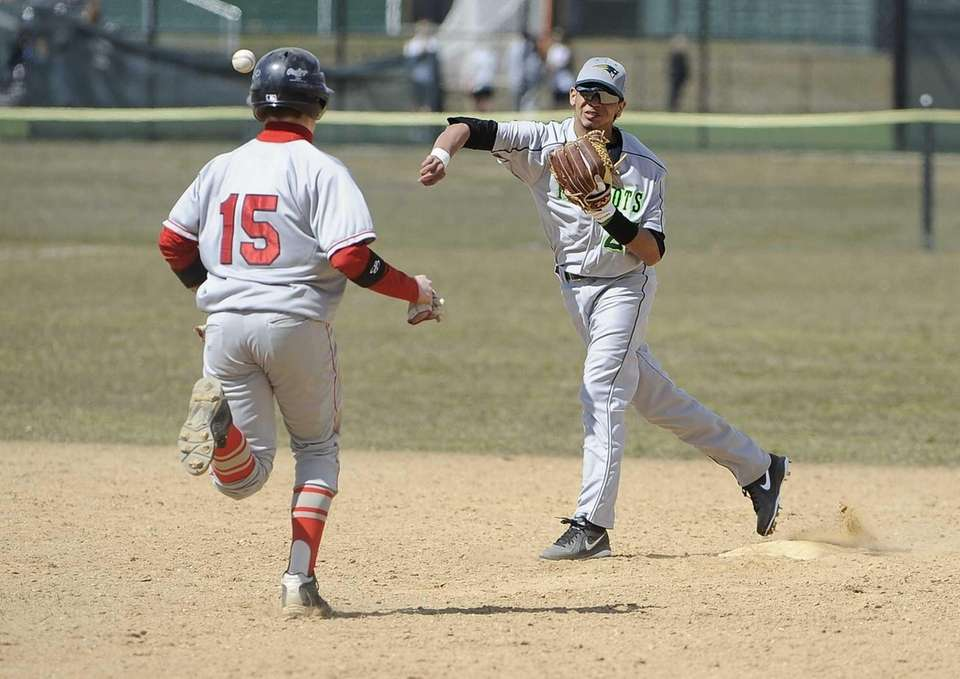 Ward Melville second baseman Christopher Cepeda throws to