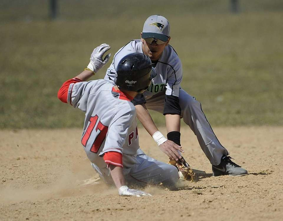 Ward Melville's Christopher Cepeda tags out Patchogue-Medford's Michael