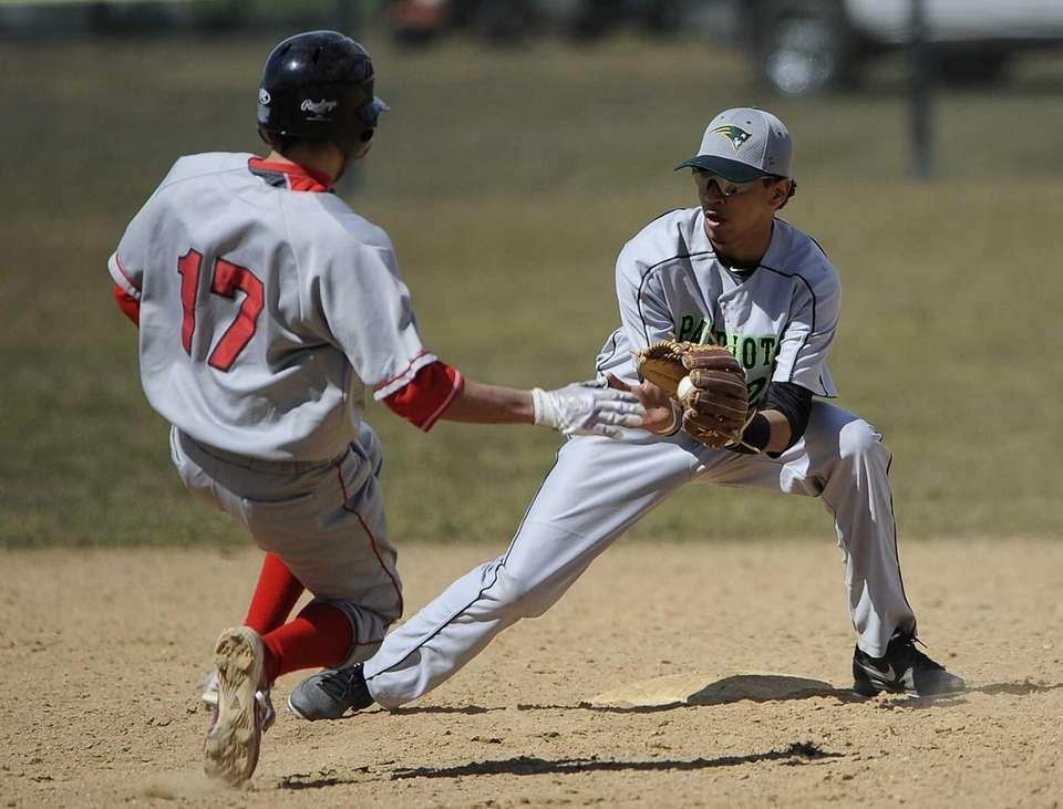 Ward Melville's Christopher Cepeda gets set to tag
