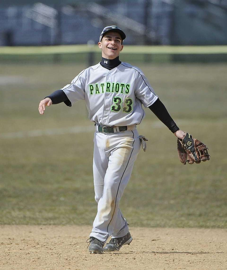 Ward Melville's Nicholas Vitale reacts after catching a
