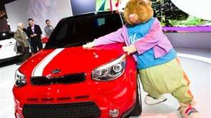 "A Kia ""Hamstar"" mascot poses for a photograph"