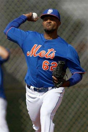Elvin Ramirez throws a bullpen session during the