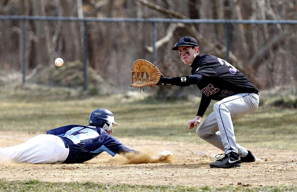 Rocky Point's Tyler Piccolo dives back to first