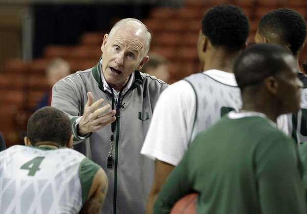 Miami head Jim Larranaga talks to his team