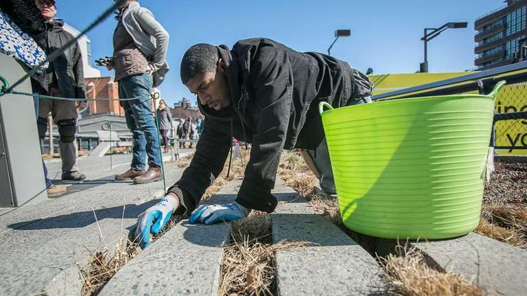 Charles Davis, 17, of Chelsea, works to clear
