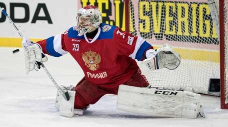 Russia goalkeeper Ilya Sorokin makes a save during