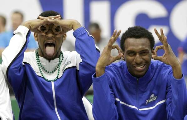 Florida Gulf Coast players Dajuan Graf, left, and