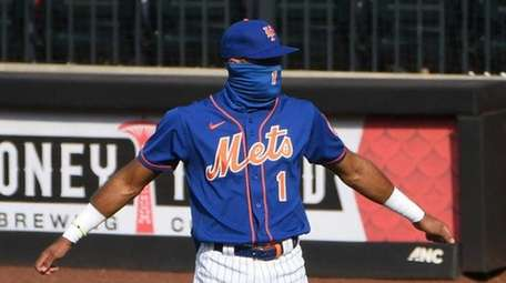 Mets shortstop Amed Rosario stretches before an MLB