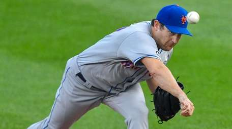Mets starting pitcher Seth Lugo throws to a