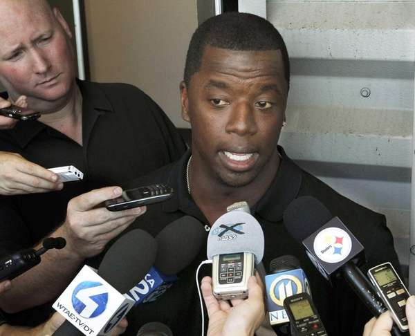Former NFL quarterback Kordell Stewart talks with reporters