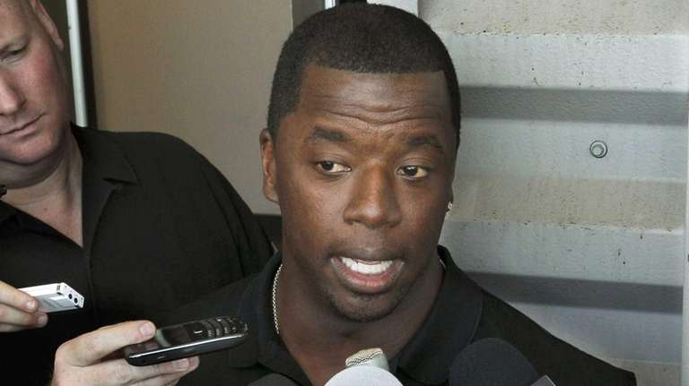 Former NFL quarterback Kordell Stewart talks with reporters