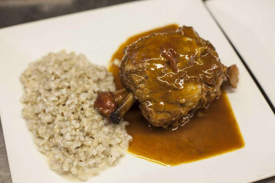 A braised veal shank served with pan jus