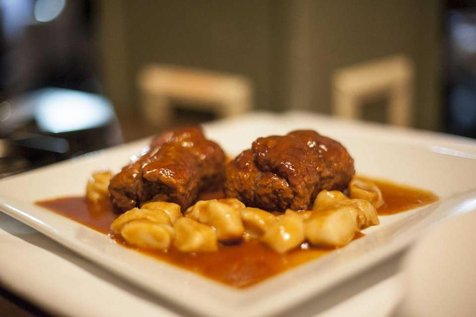 Airy gnocchi accompany a savory, tender, zeppelin-size beef