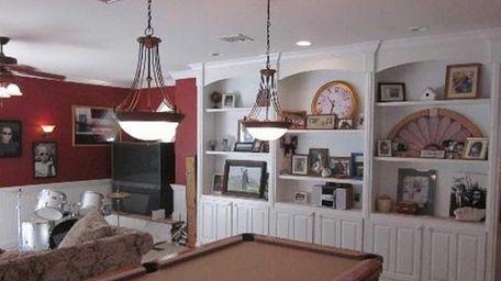 The formal living room, formal dining room, den