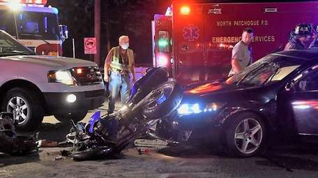 A motorcyclist and a car collided on North