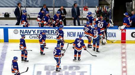 The Islanders leave the ice after their 4-1
