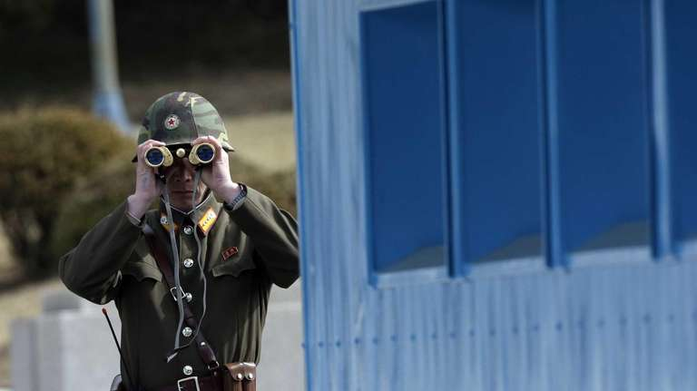 A North Korean soldier looks at the southern