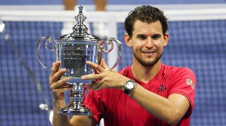 Dominic Thiem of Austria celebrates with the championship