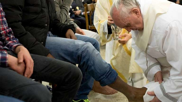 Pope Francis washes the foot of an inmate