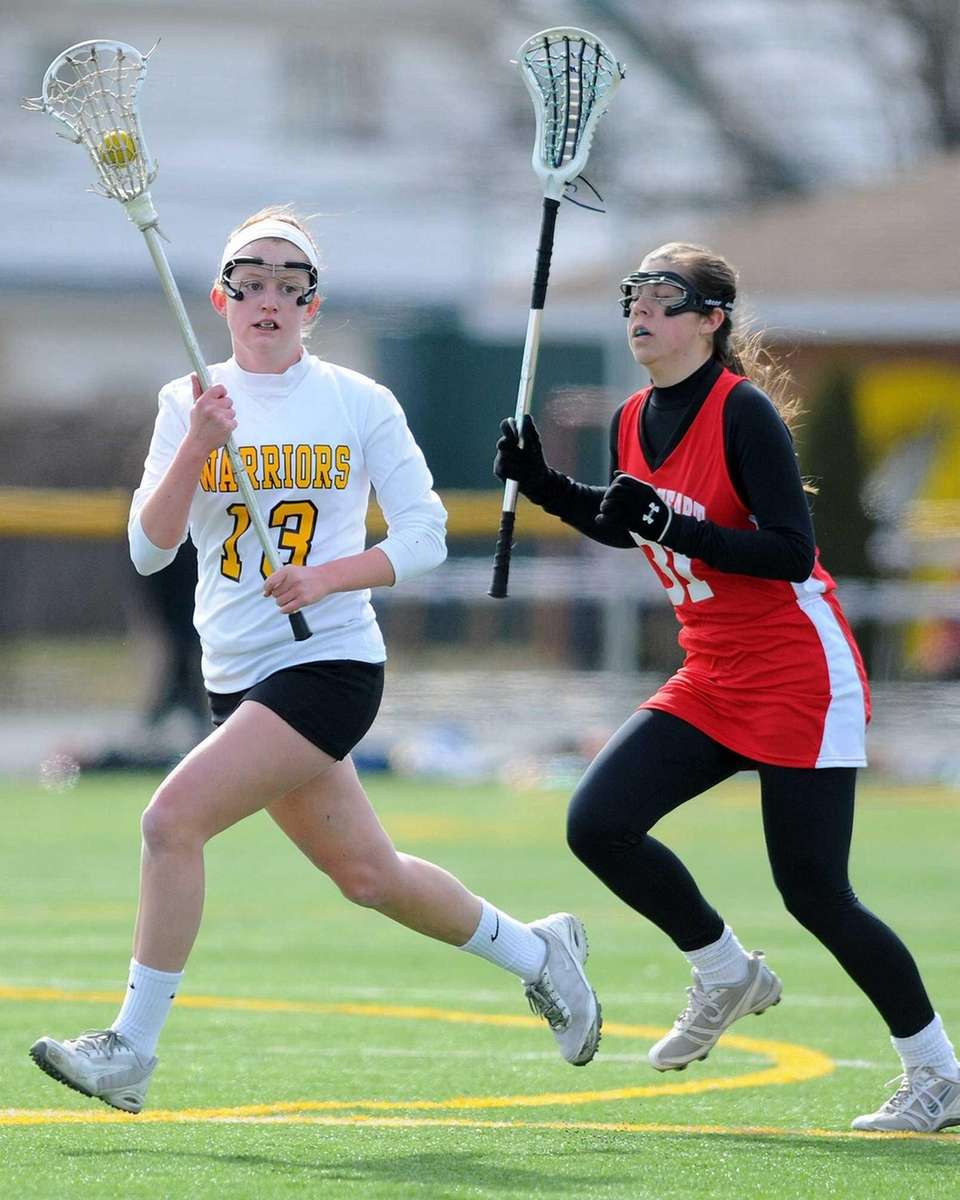 Wantagh's Brenna Connolly, left, carries past Sacred Heart