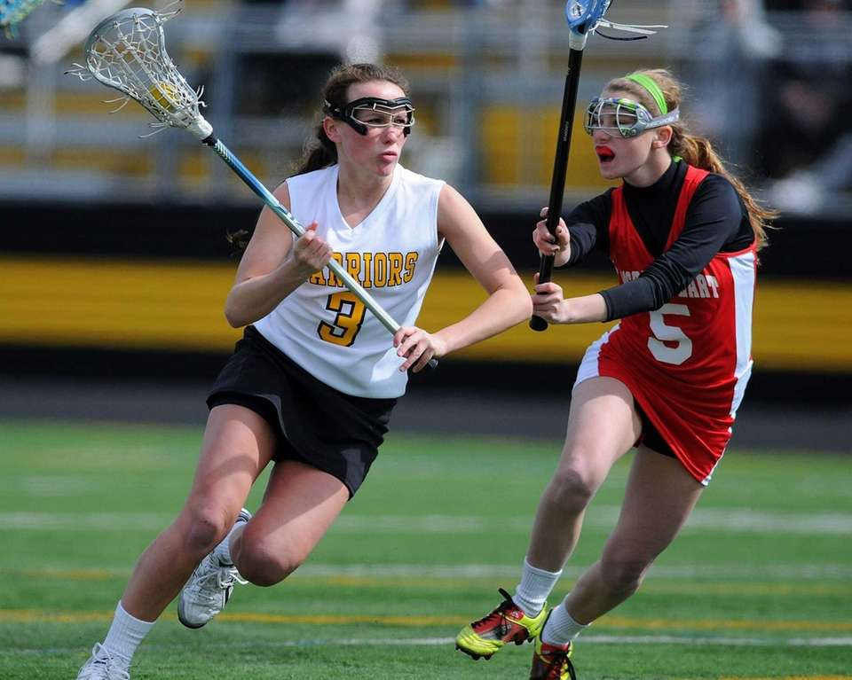 Wantagh's Colleen Lovett, left, gets pressured by Sacred