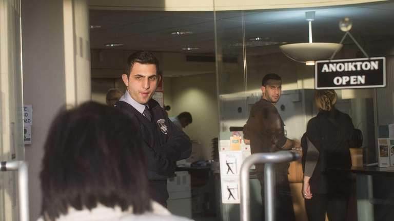 Customers wait patiently in lines as Cyprus' banks