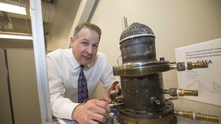 Chief executive Paul Schwartz shows a heat pump