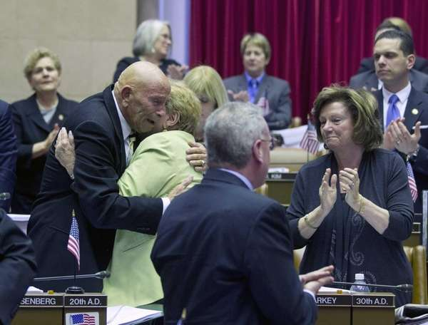 Assemblyman Harvey Weisenberg, D-Long Beach, is embraced by