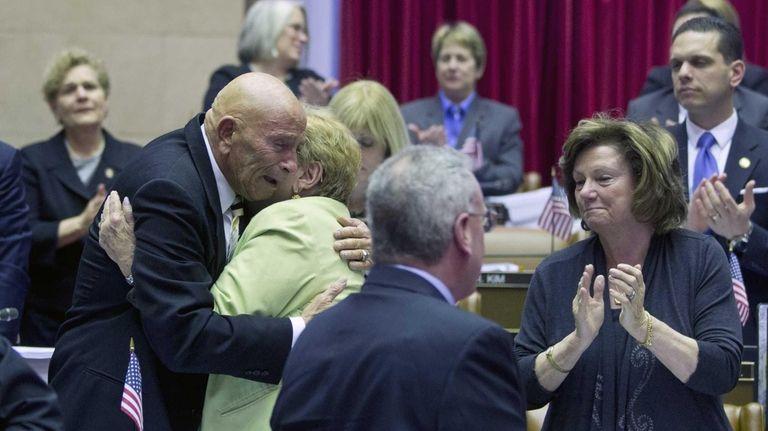 Assemblyman Harvey Weisenberg, D-Long Beach, is embraced by
