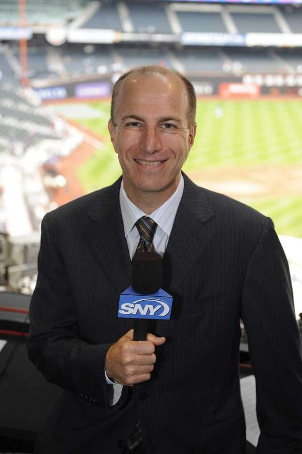SNY's Gary Cohen poses in the booth.